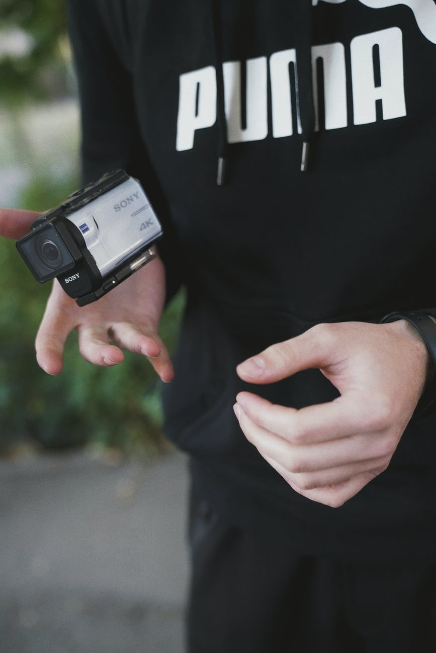 photo of person holding action camera